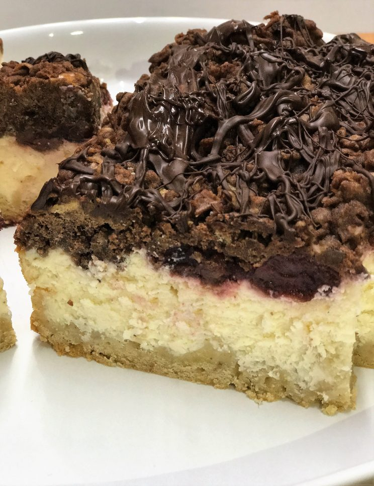 cherry vanilla mousse cheesecake with chocolate and vanilla cookie